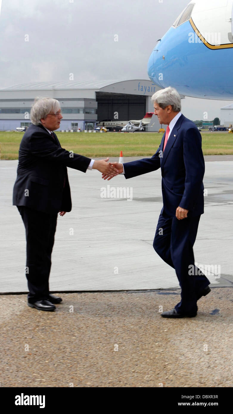 Secretary Kerry Is Greeted By Acting Deputy Chief of Mission Tokola - Stock Image
