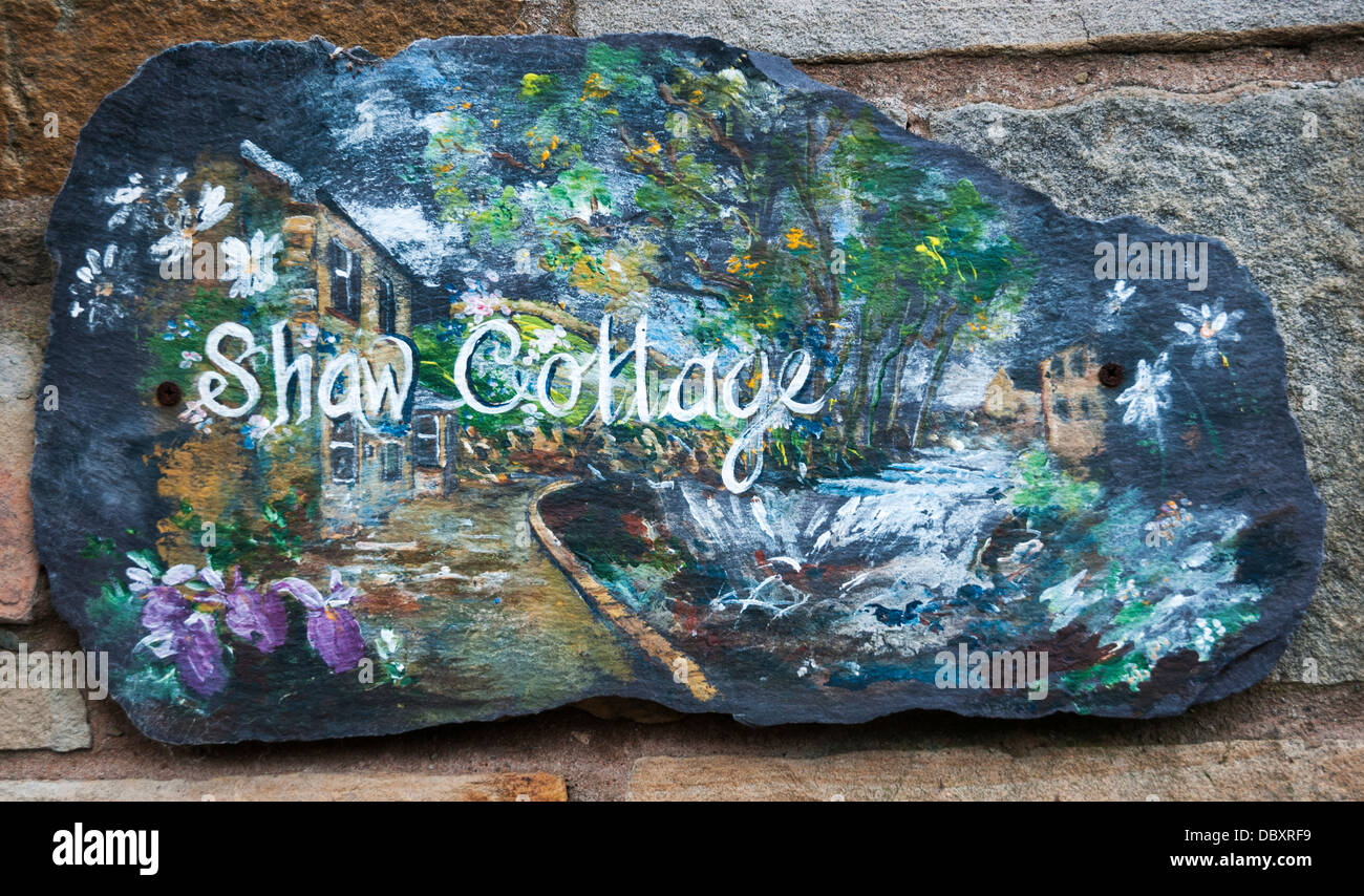 Great Britain, England, North Yorkshire, Wensleydale, Hawes, Shaw Cottage, hand painted cottage house sign - Stock Image