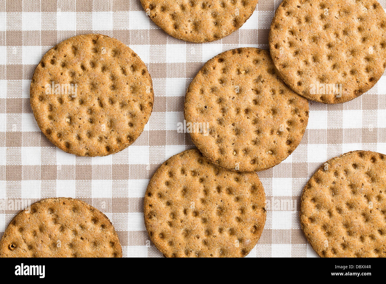 the crispbread on checkered tablecloth - Stock Image