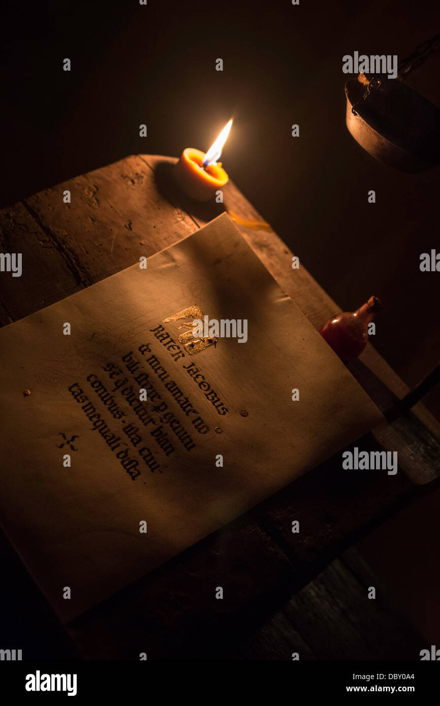 Old book handwritten at candlelit - Stock Image