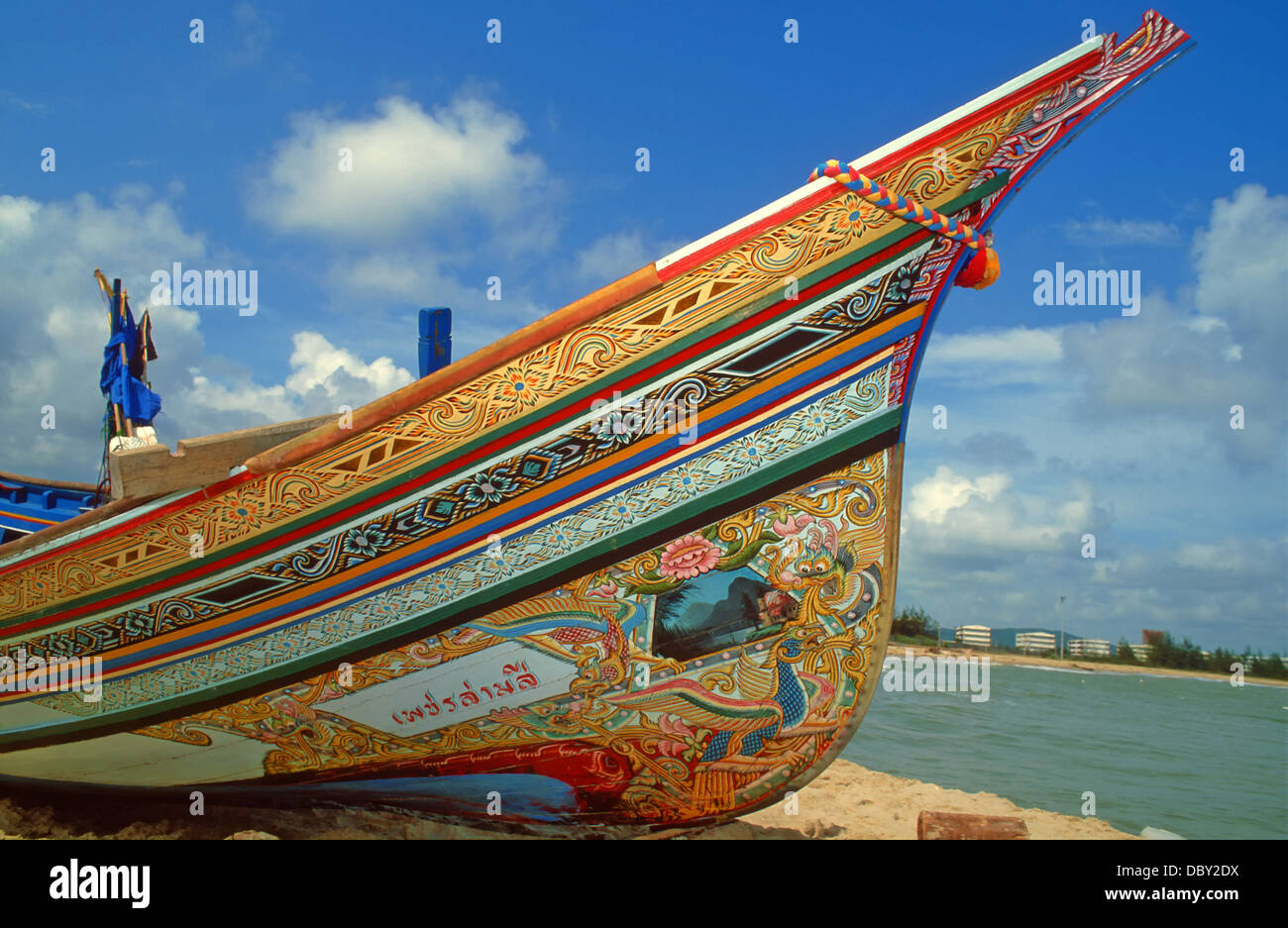 Colourful traditional hand-painted fishing boat common to the area of Songkhla in Southern Thailand. Stock Photo