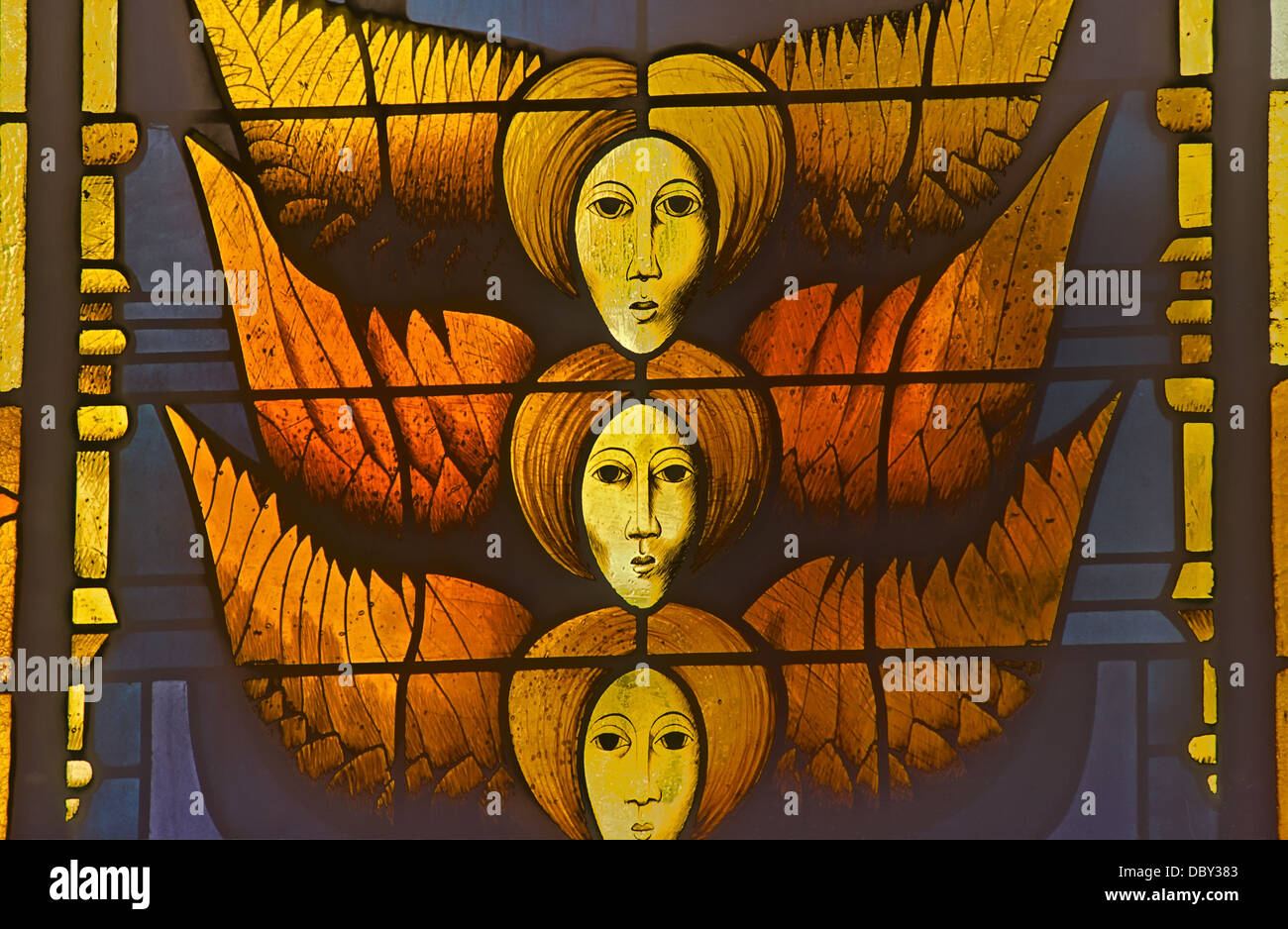 Very modern stained glass window at the Church of Saints Simon and Jude at Oberembt in Germany.It shows three angels. Stock Photo