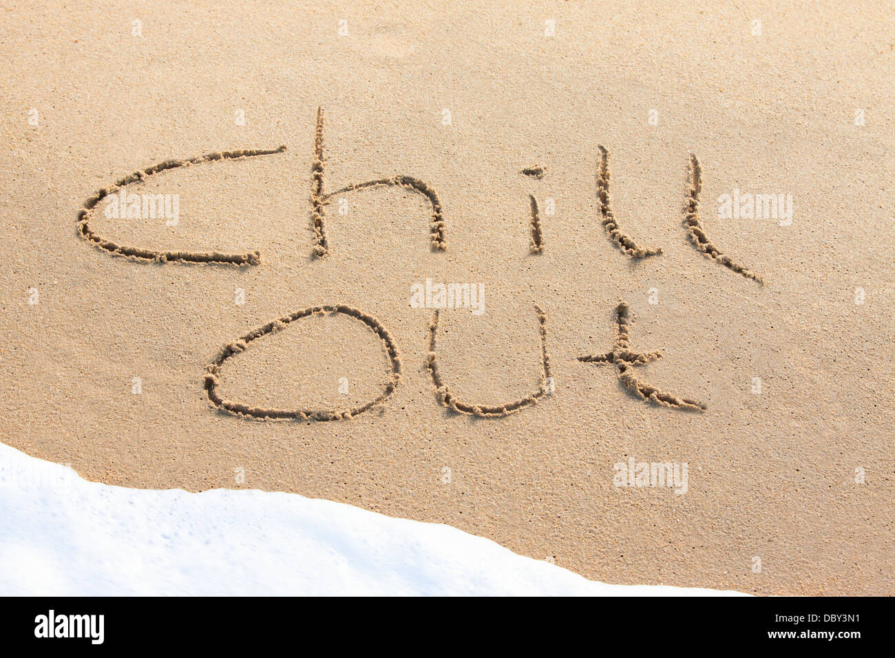Chill out - written in the sand - Stock Image