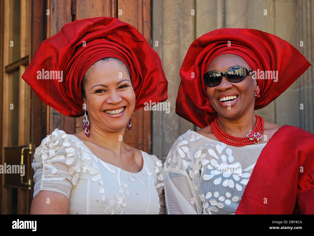 American women in Nigerian dress celebrating at a 50th birthday  in Florence, Italy - Stock Image