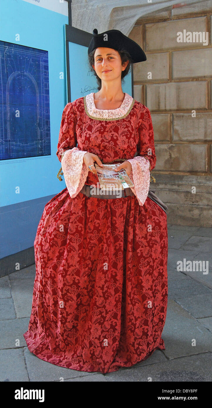 A pretty young lady in costume in Italy promoting Tosca operas at the Venice opera House - Stock Image