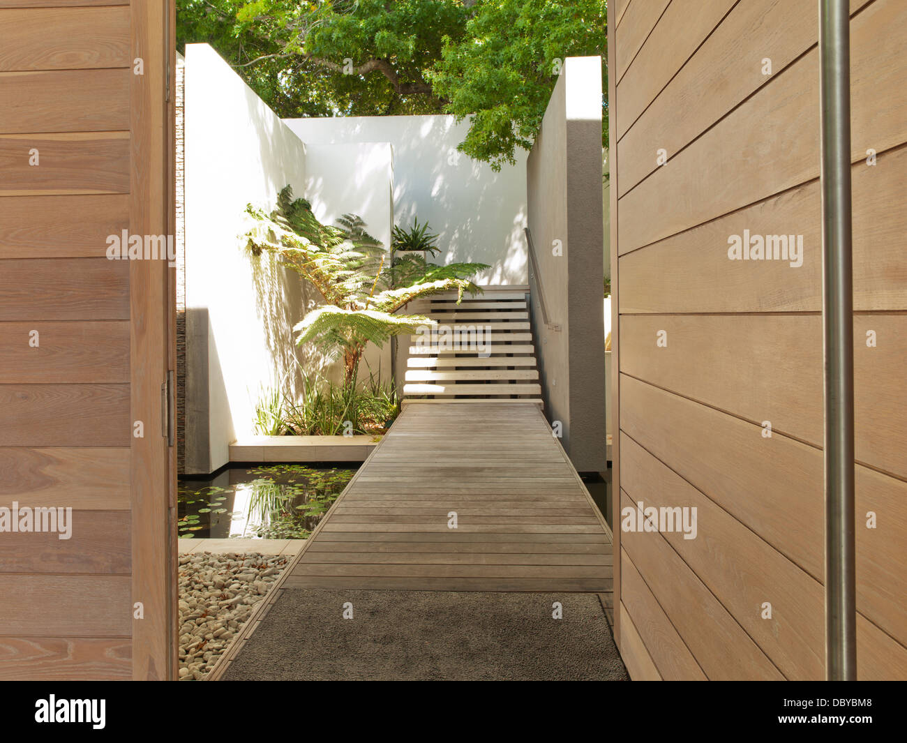 Footbridge and stairs modern courtyard - Stock Image