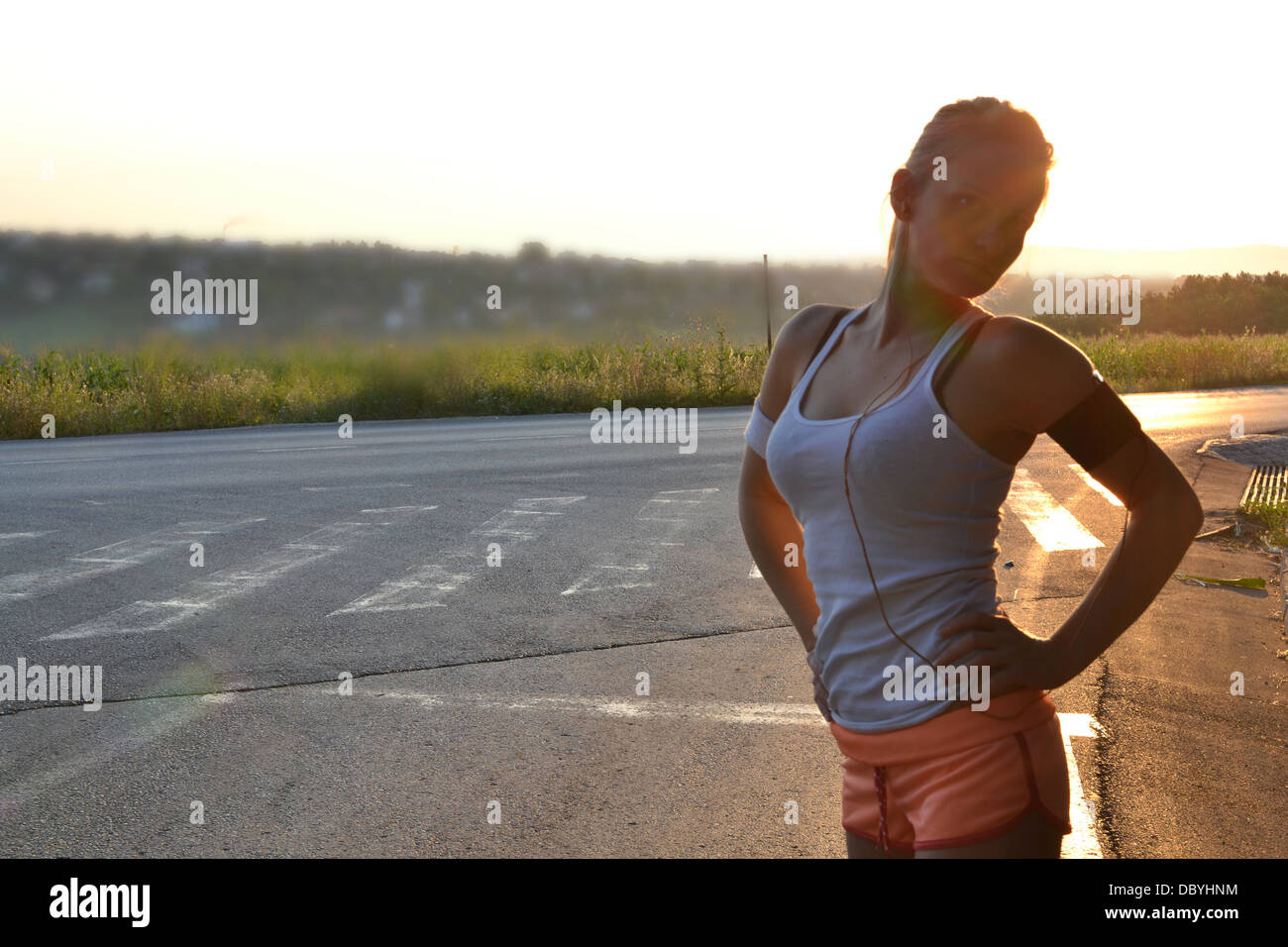 young woman working out in the park - Stock Image