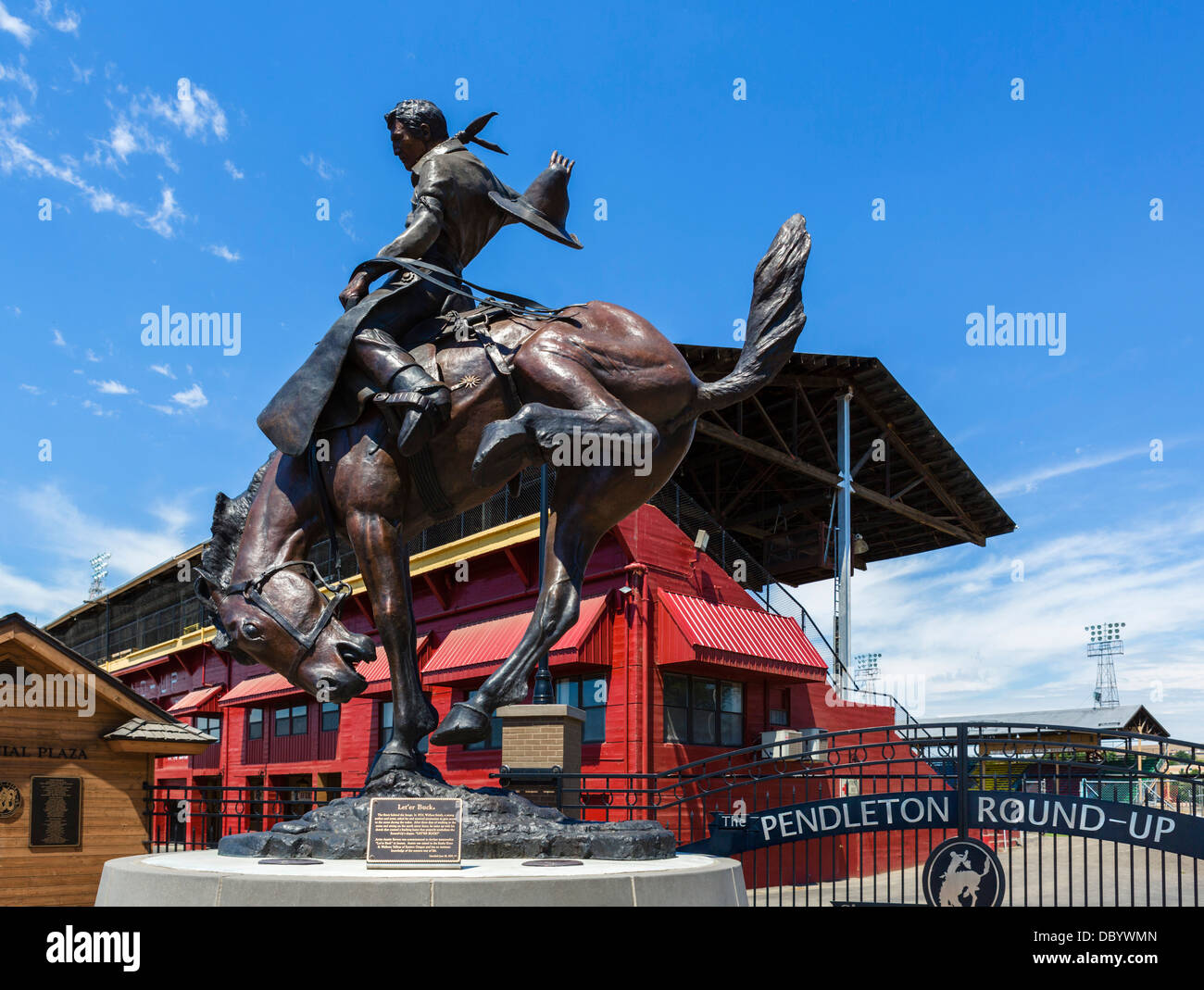Let'er Buck sculpture in front of the Pendleton Round-Up rodeo stadium, Pendleton, Oregon, USA - Stock Image
