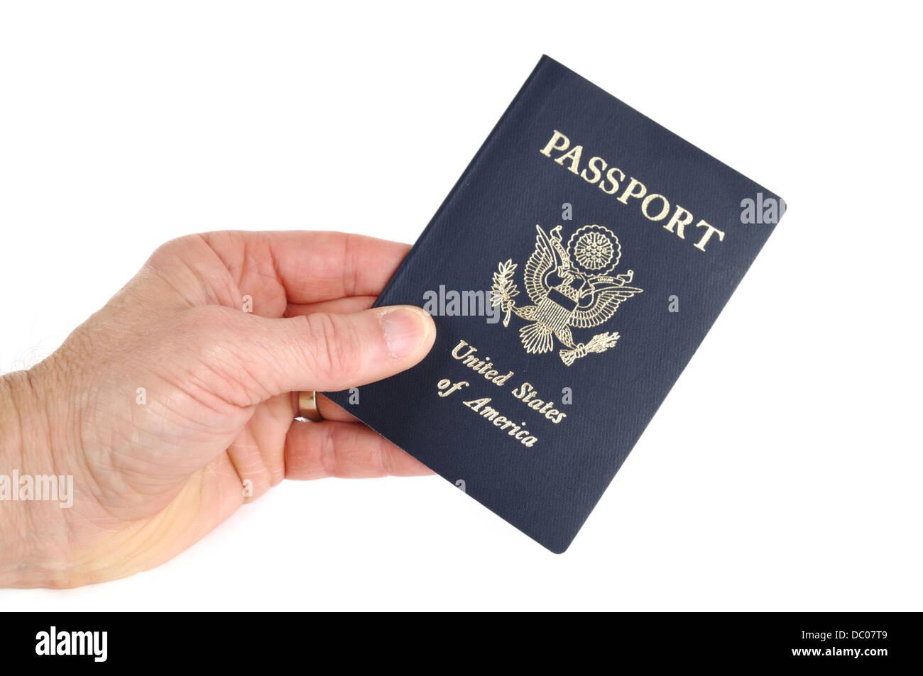 Hand holding a US passport - Stock Image