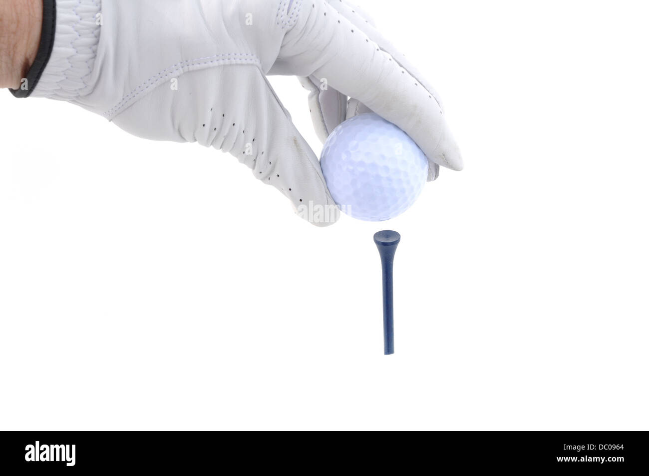 Golfer placing a golf ball on a tee - Stock Image