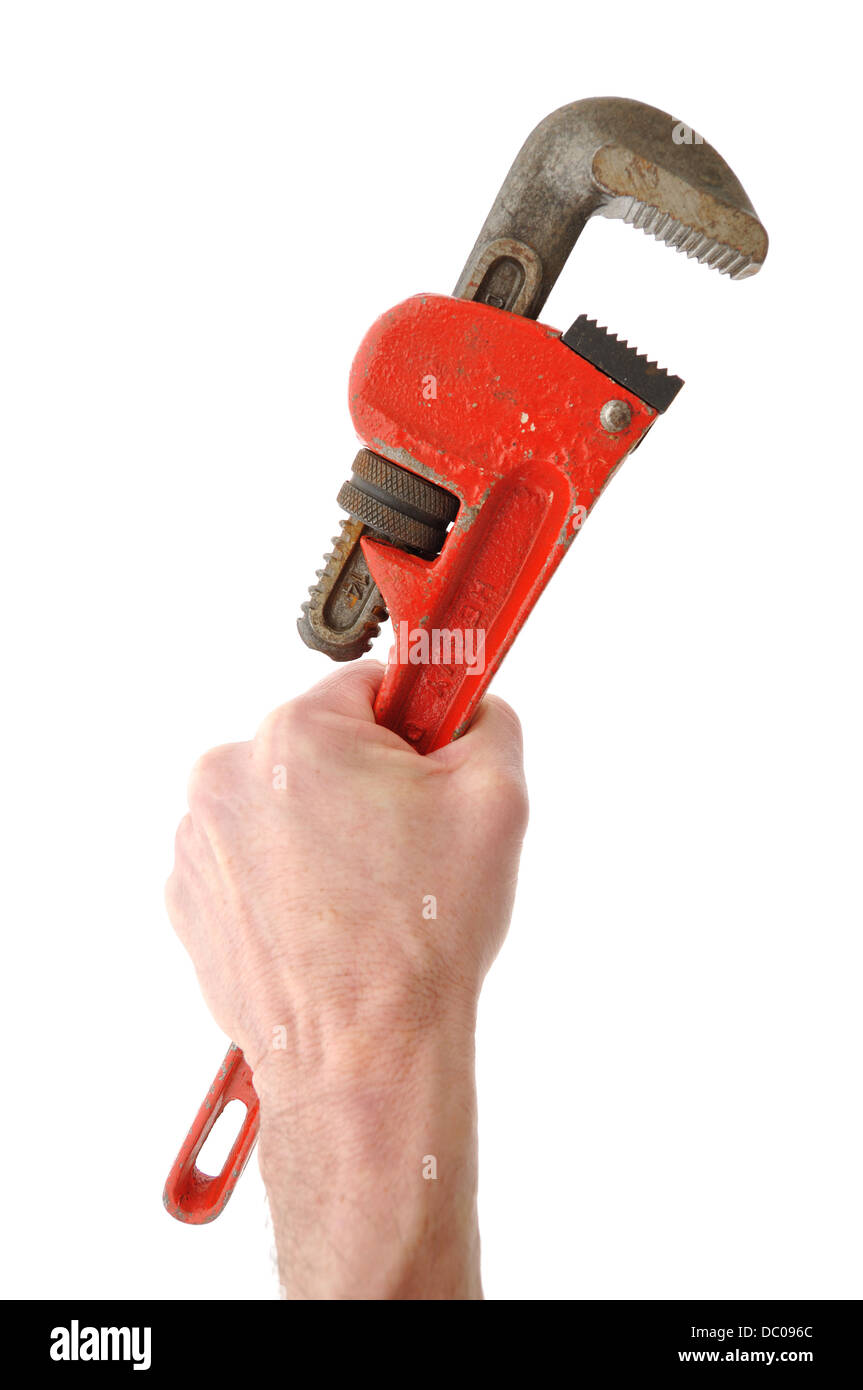 Hand holding a pipe wrench / Stillson wrench - Stock Image