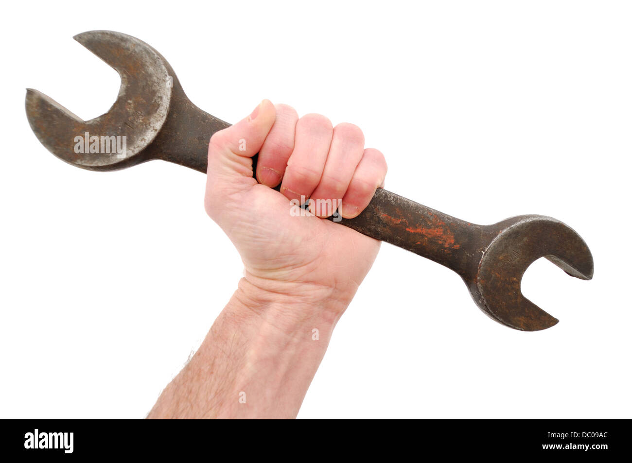 Hand holding a large open end spanner / wrench - Stock Image