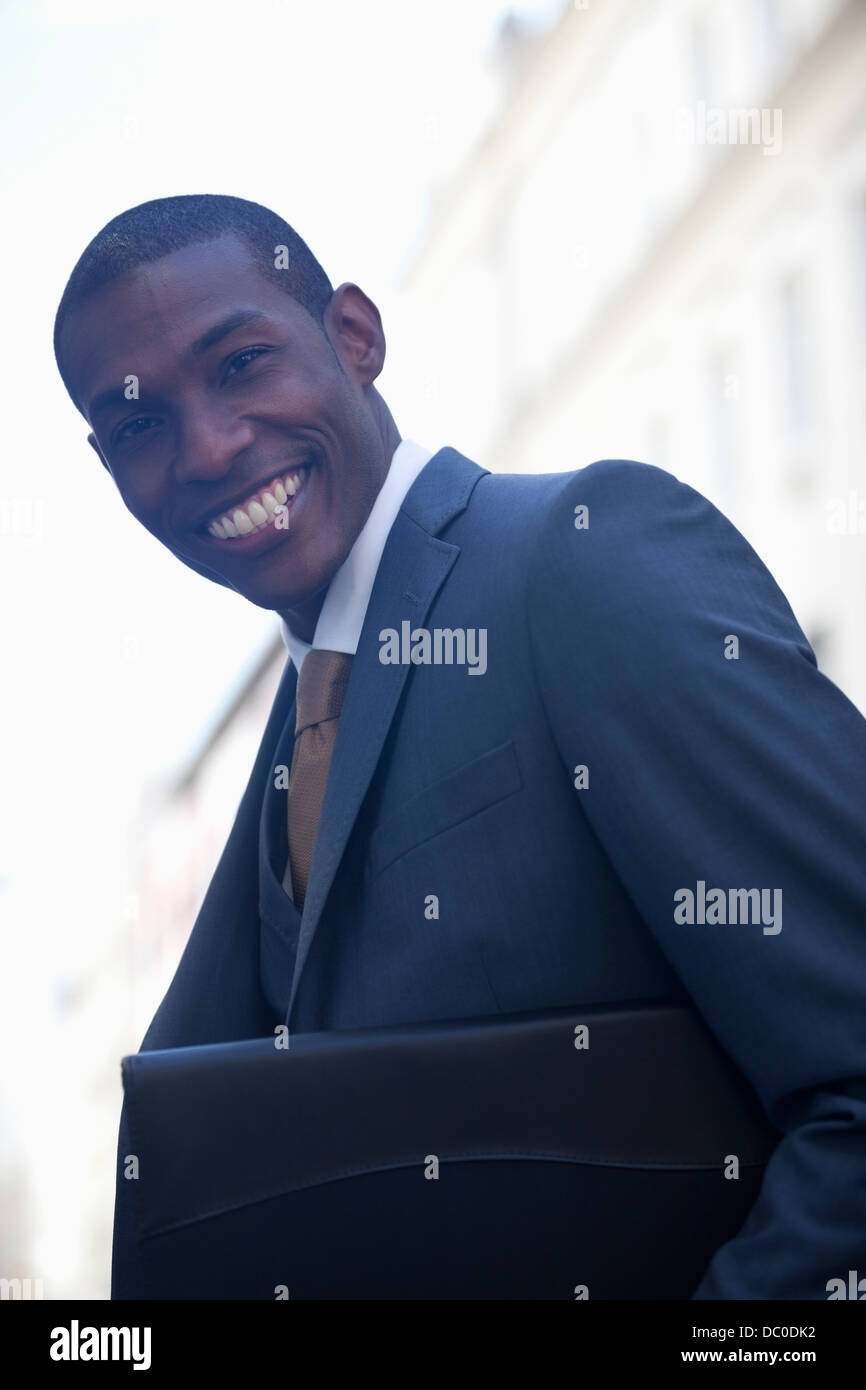 Portrait of smiling businessman - Stock Image