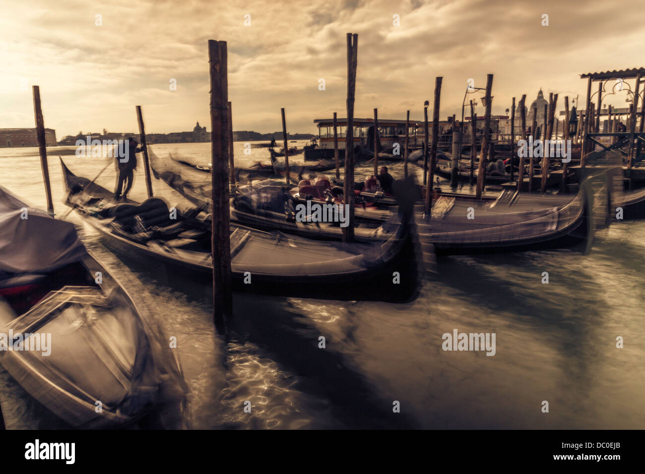 venice, gondolas, sunset, sepia, waves, gondolier - Stock Image