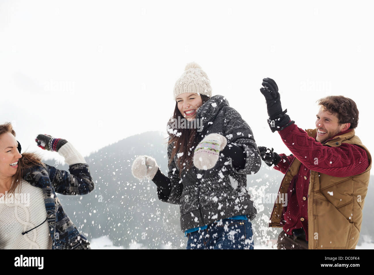 Couple enjoying snowball fight - Stock Image