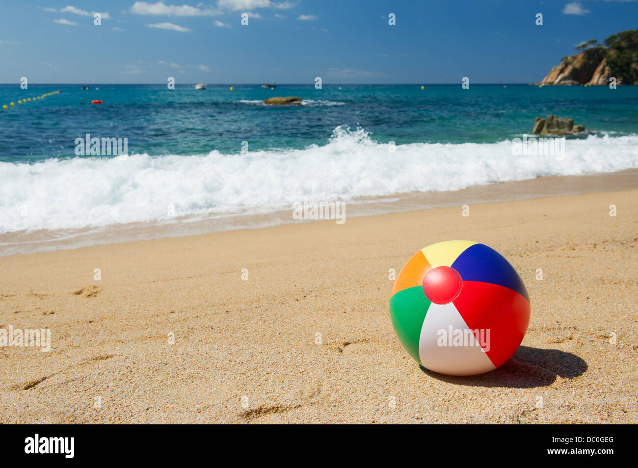 beach ball in sand. Delighful Beach Inflatable Beach Ball In The Sand Near Water Line At Spanish   Stock With Beach Ball In Sand S