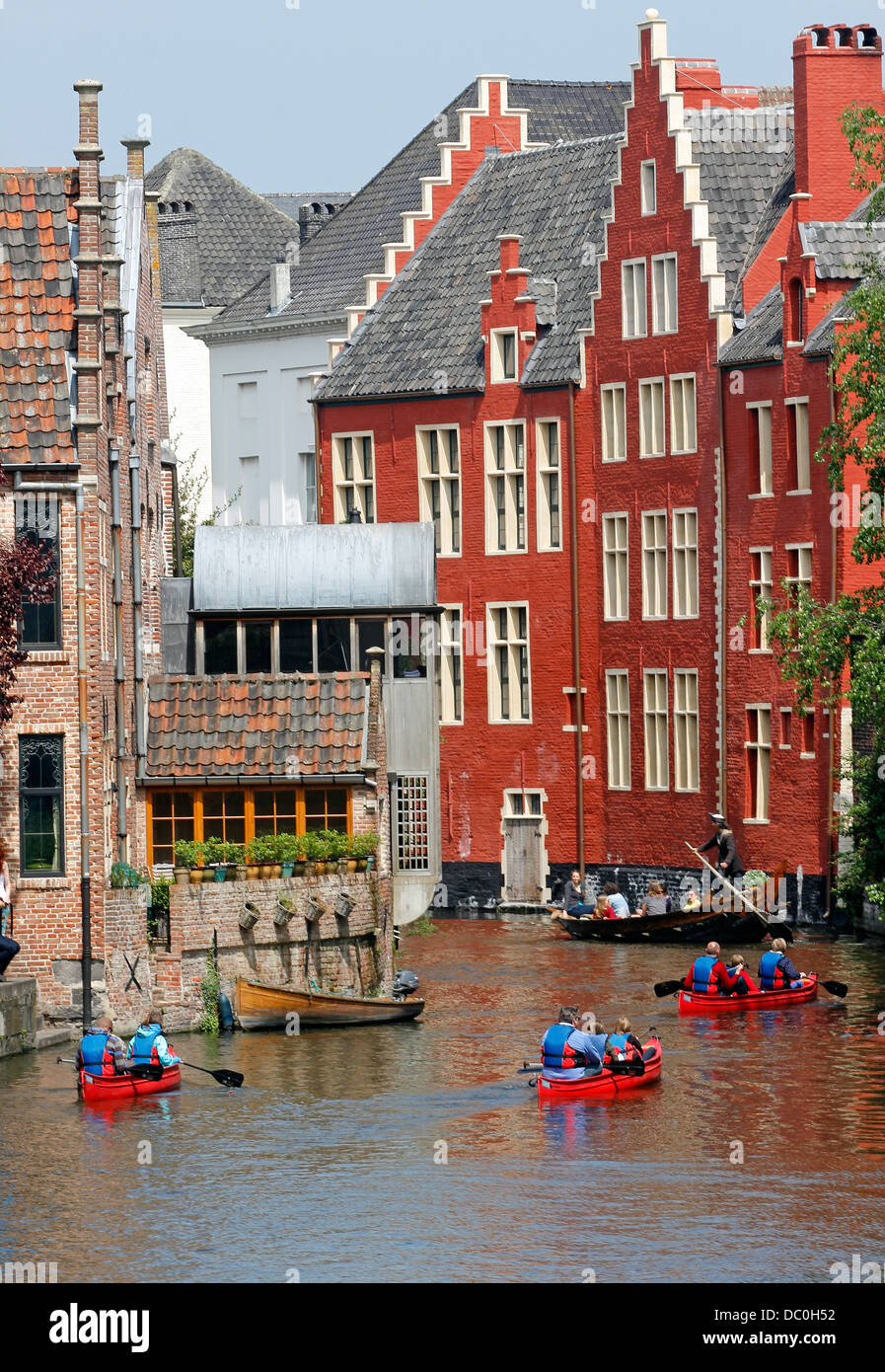 Ghent Belgium Europe canal tour boats medieval guild houses and cafes canoes sunny Sunday - Stock Image
