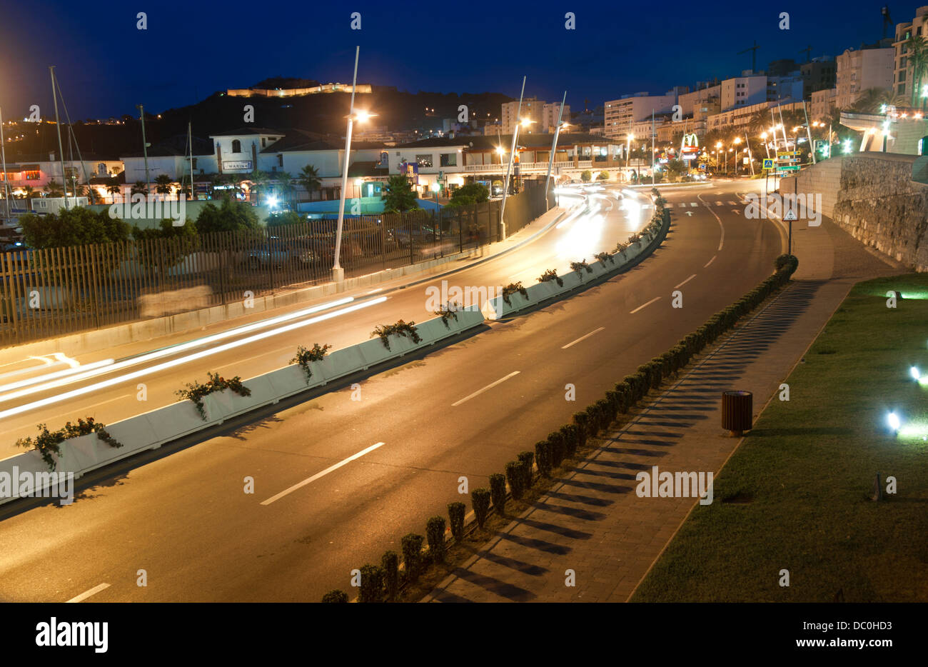 Paseo de las Palmeras road and Monte Hacho Castle in background .Ceuta . Spain. - Stock Image