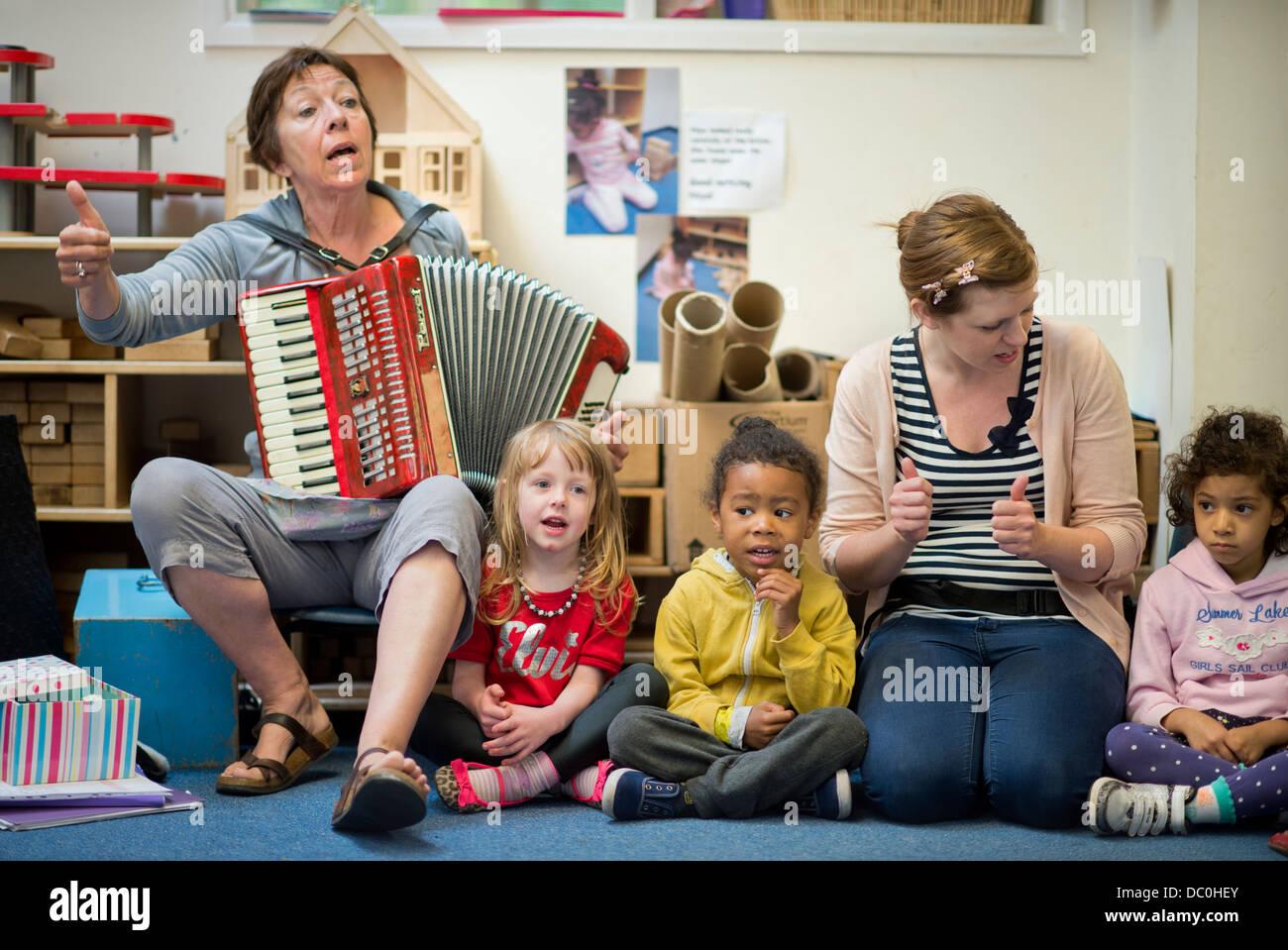 St. Pauls Nursery School and Children's Centre, Bristol UK 2013 - A music class. - Stock Image