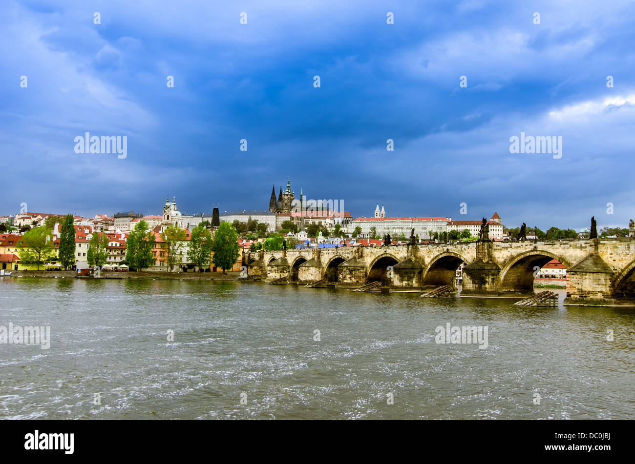 Panoramic view of Prague,capital of Czech Republic, over the Vltava river with St Vitus Cathedral city castle and - Stock Image
