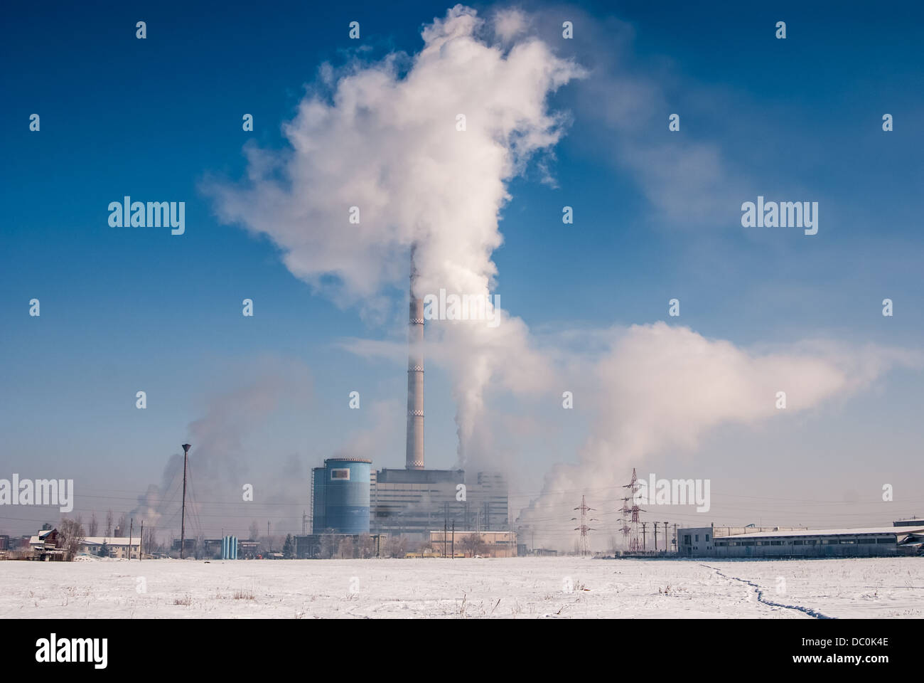 Heavy industry makes problems with a global warming. Smoke and steam cause environmental pollution destroying - Stock Image