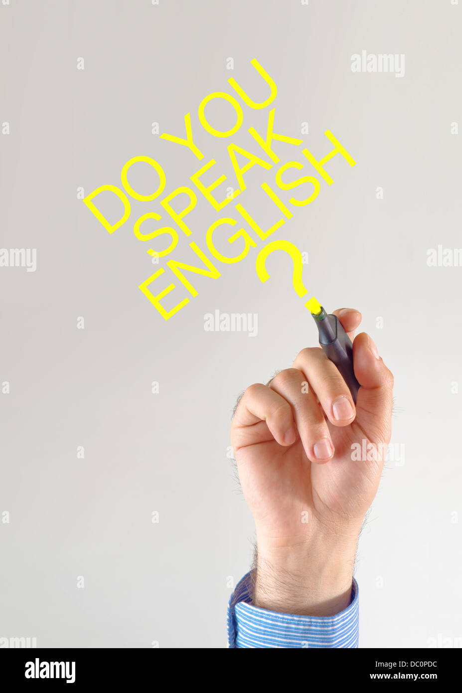 Do you speak English. Teacher writing with yellow marker pen on the screen - Stock Image
