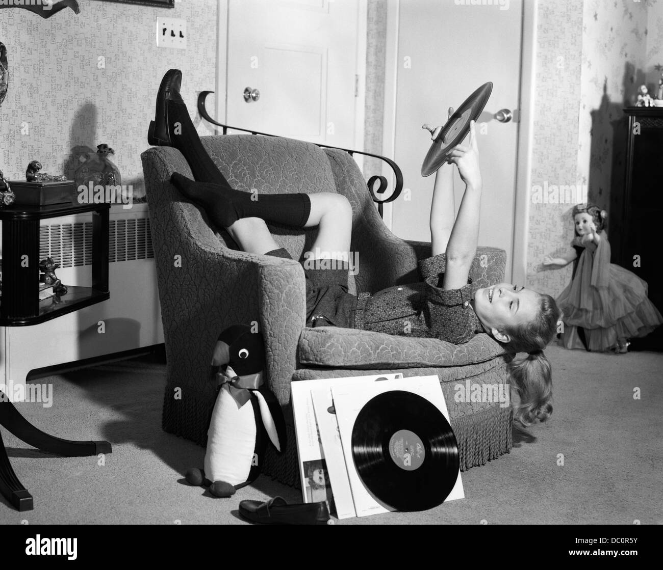 1950s 1960s Teenage Girl Smiling Reclining Upside Down On