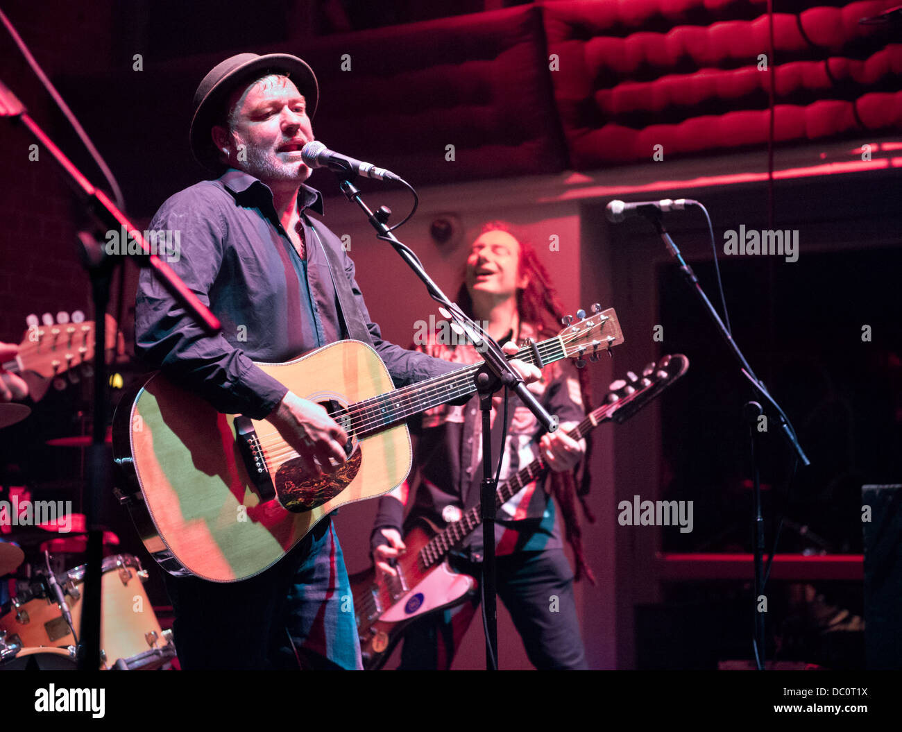 Mark Chadwick and Jeremy Cunningham with their band, The Levellers in concert at the Buttermarket, Shrewsbury, UK, - Stock Image