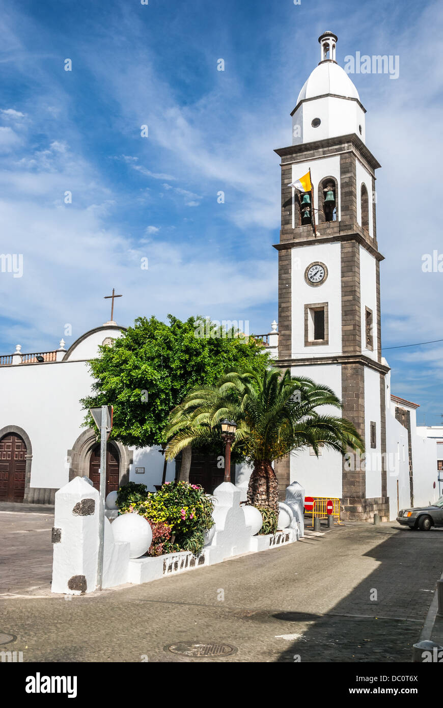 The beautiful church of San Gines in Arrecife with its white-washed exterior and attractive bell tower - Stock Image