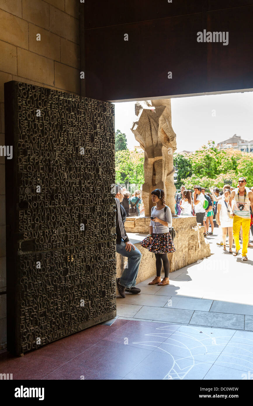 the highly decorated central bronze relief door to La Sagrada Familia Stock Photo