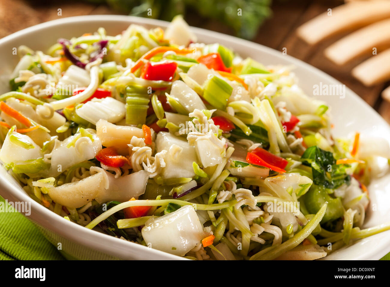 Asian Bok Choy and Ramen Salad in a Bowl - Stock Image