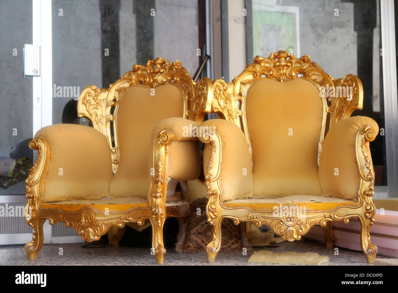 Gold Ornate Chairs Wait Outside A Shop To Be Upholstered In Dibba, Oman