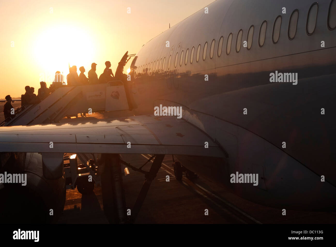 passengers boarding airplane - Stock Image