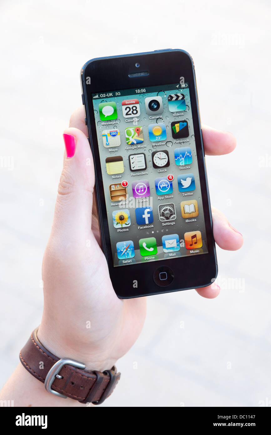Home screen of black Apple iPhone 5 - Stock Image