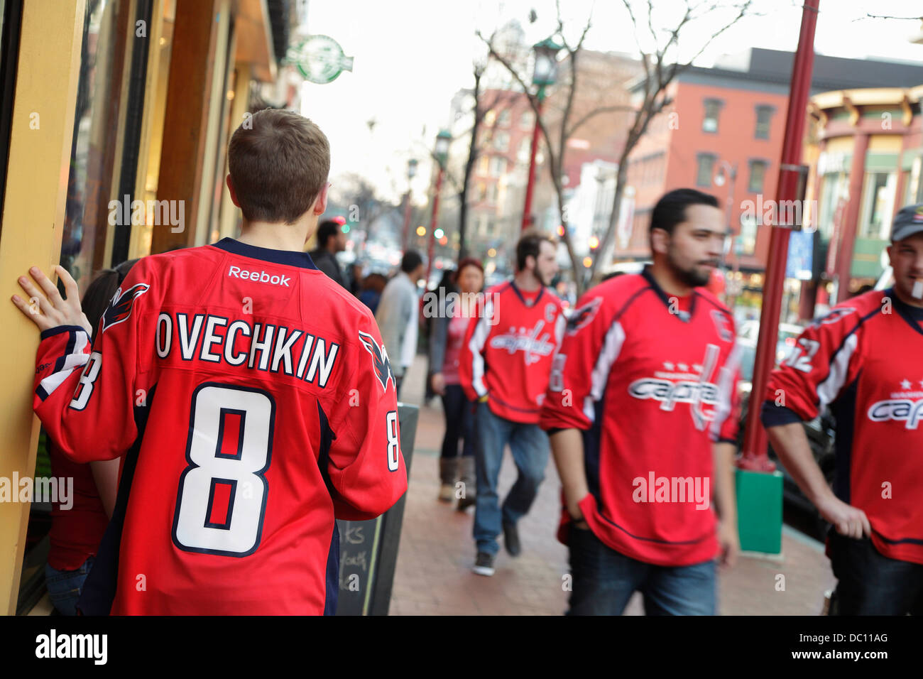 0d8c75ba919 NHL hockey fans wearing Washington Capitals jerseys on 7th St. NW outside  the Verizon Center