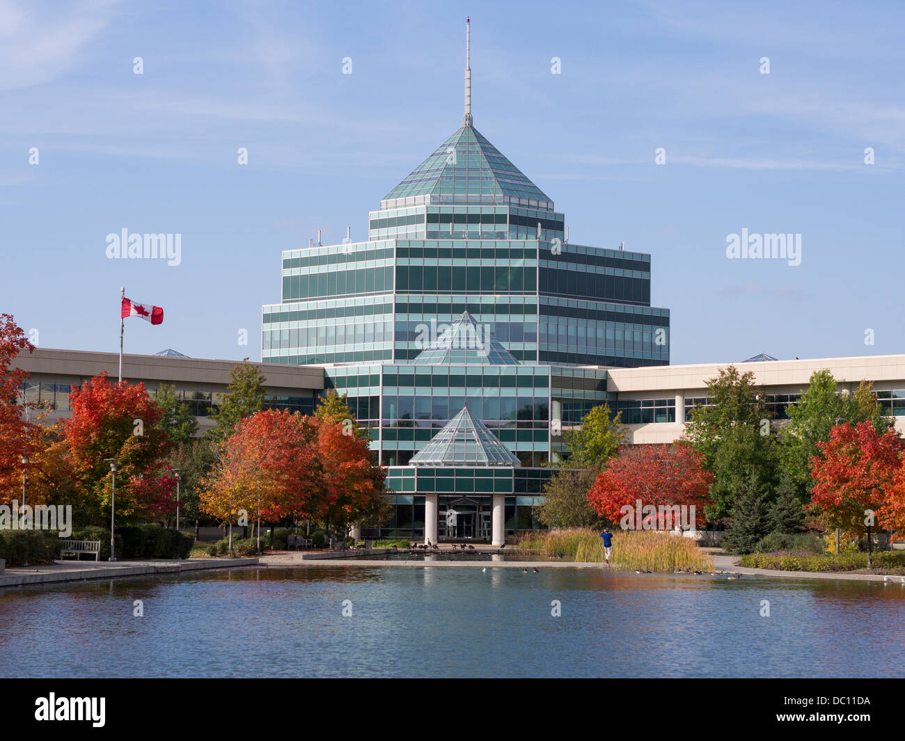 Atrium and reflecting pool at the Nortel Campus. The central atrium with its iconic glowing beacon surrounded by - Stock Image