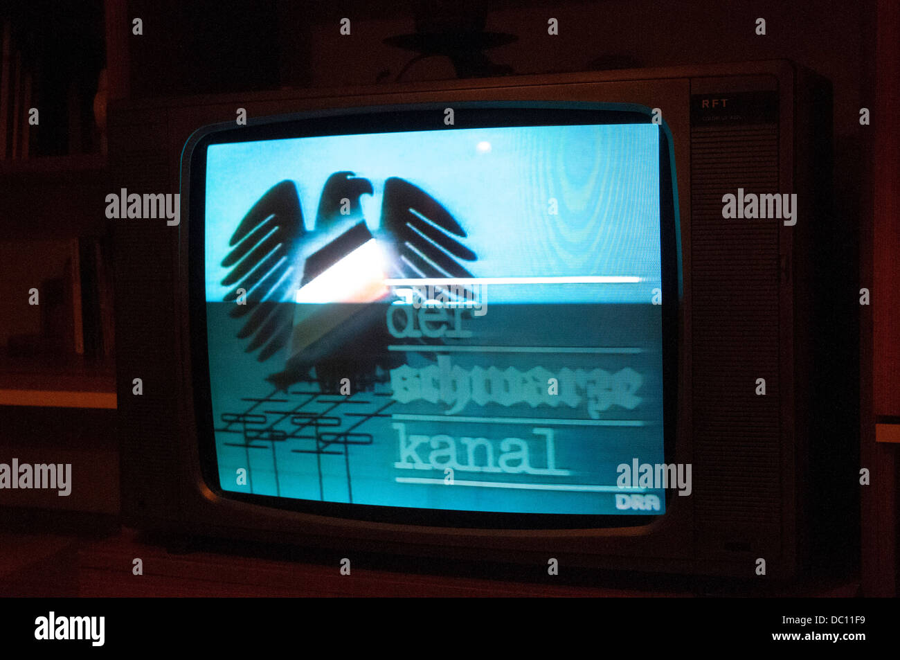 Germany, Berlin. Alexanderplatz. DDR Museum. TV playing the Black Channel. - Stock Image