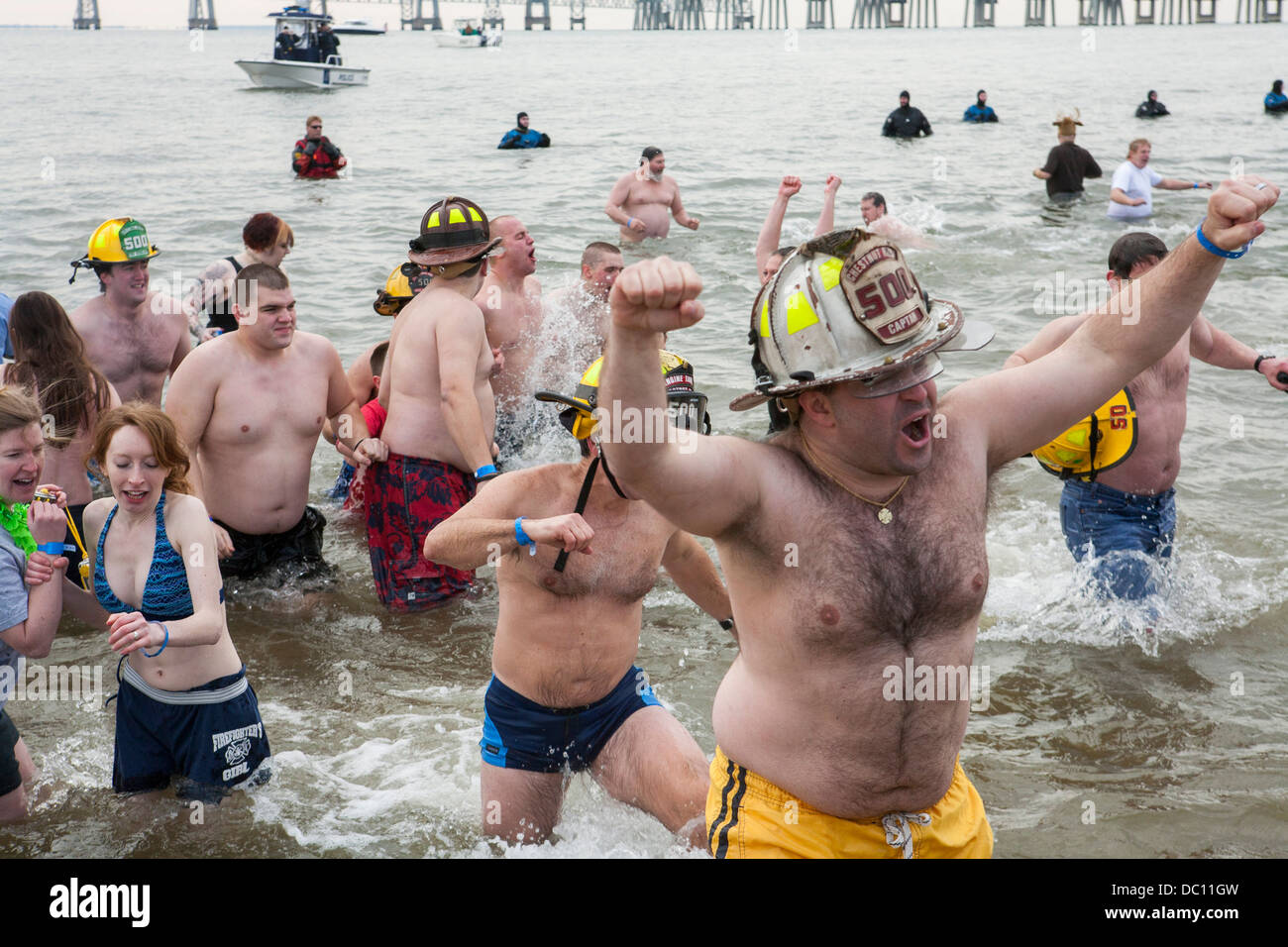 A polar bear plunge event where participants jump into ice cold water during the winter.  - Stock Image