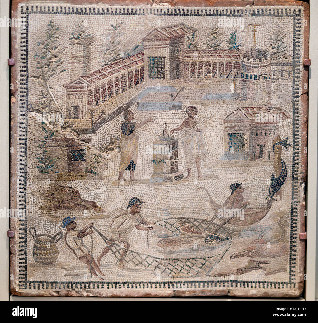 Roman Mosaic floor from Ostia, Italy. Mosaic with a man and a woman sacrificing in a seaside landscape. - Stock Image
