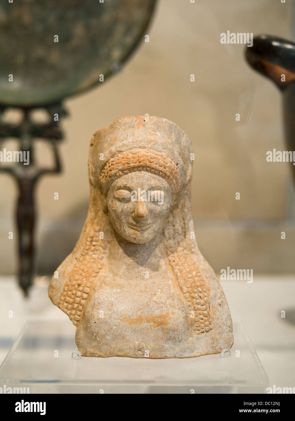Bust of the Goddess Demeter. Molded and fired earthenware (terracotta) with traces of red pigment from Sicily, 500 - Stock Image