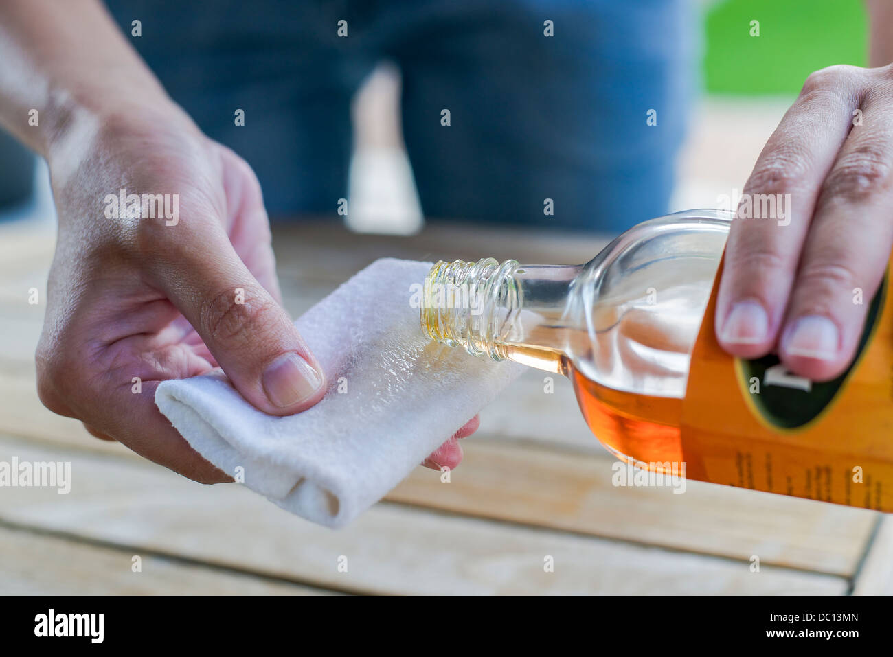 impregnate wooden table with oil - Stock Image