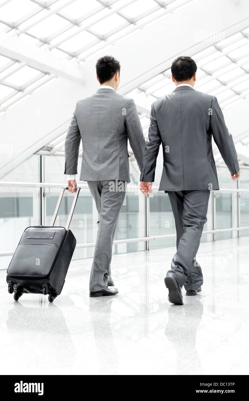Business partners on the move in airport lobby - Stock Image