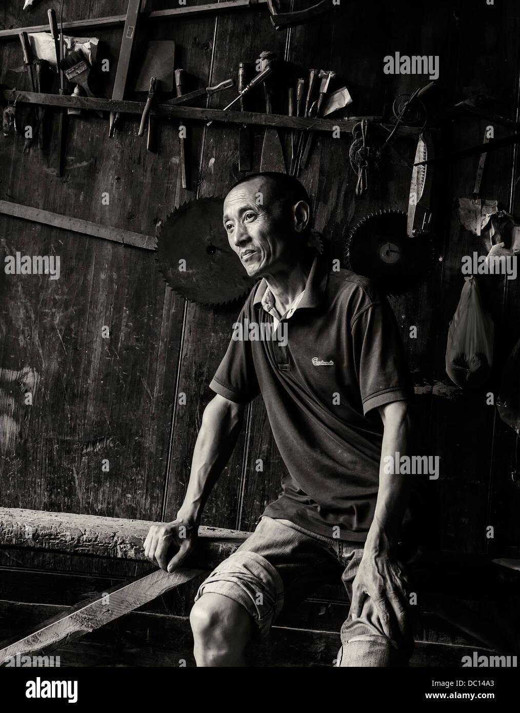 miao wood artisan in the  western Hunan Province,China. - Stock Image