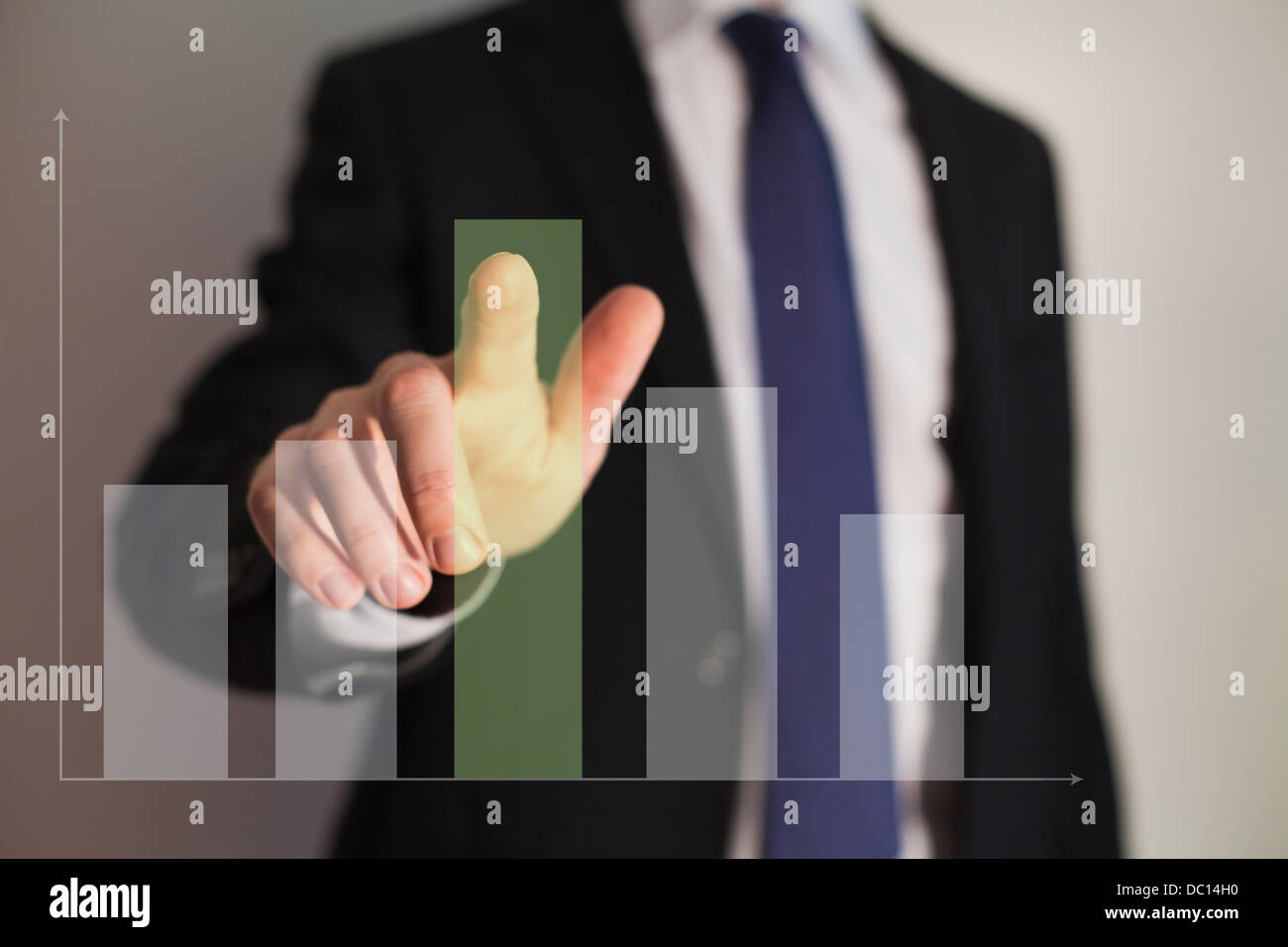 Businessman presenting a successful sustainable development on a bar chart - Stock Image