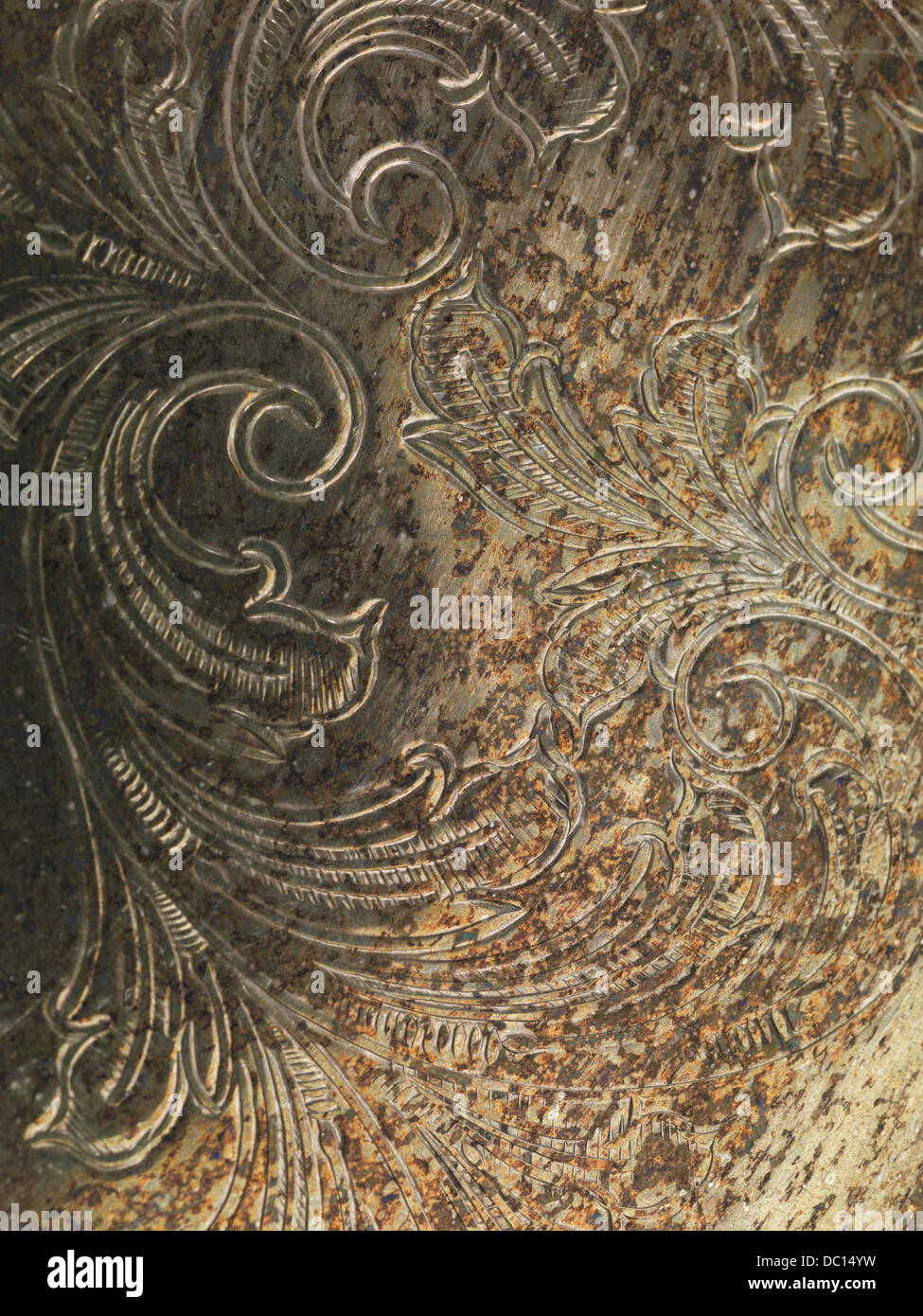 Oxidized grungy rusted metal texture background with ornament - Stock Image