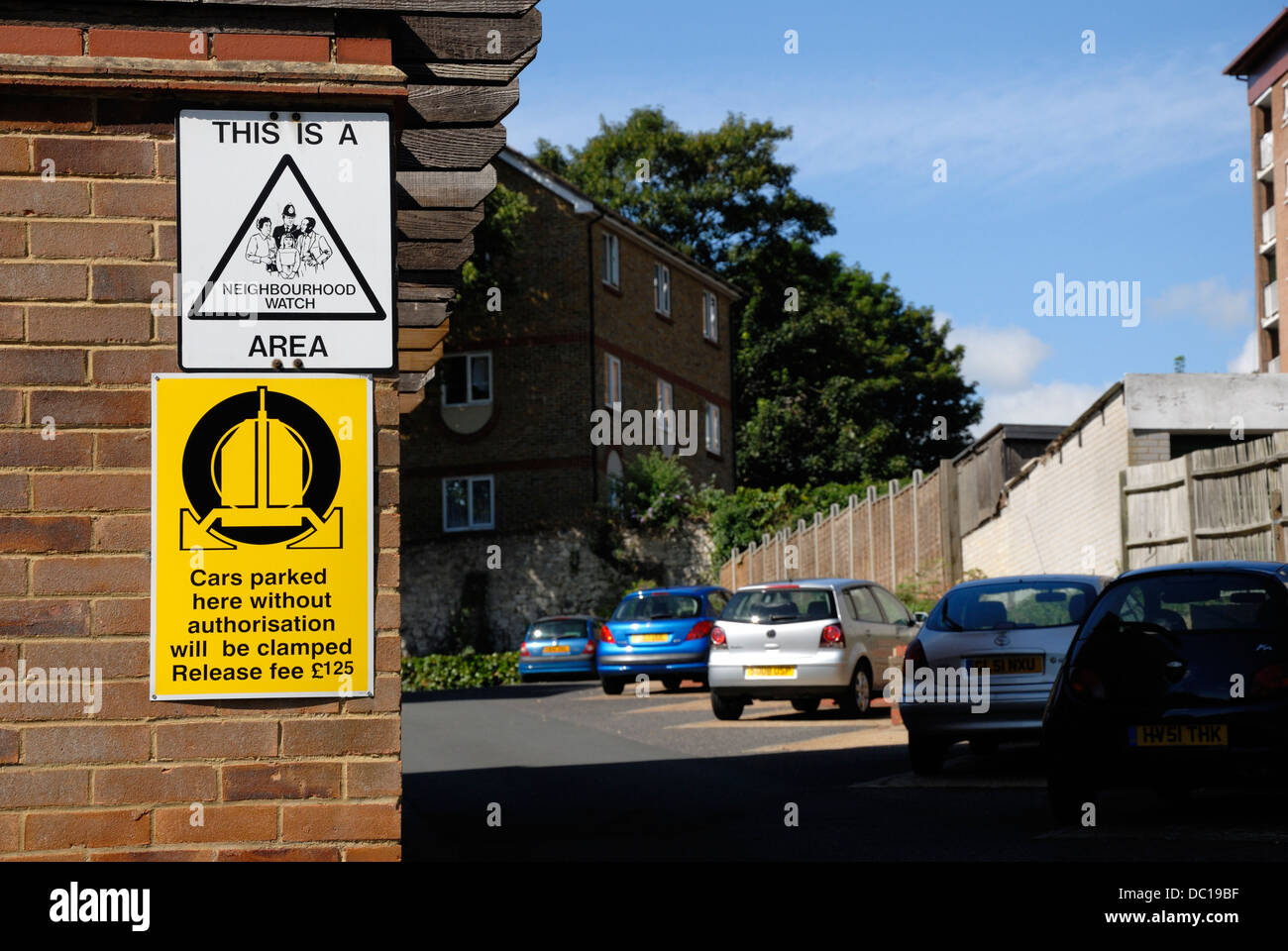 Maidstone, Kent, England, UK. Signs in residential area - Neibourhood Watch and wheel clamping - Stock Image