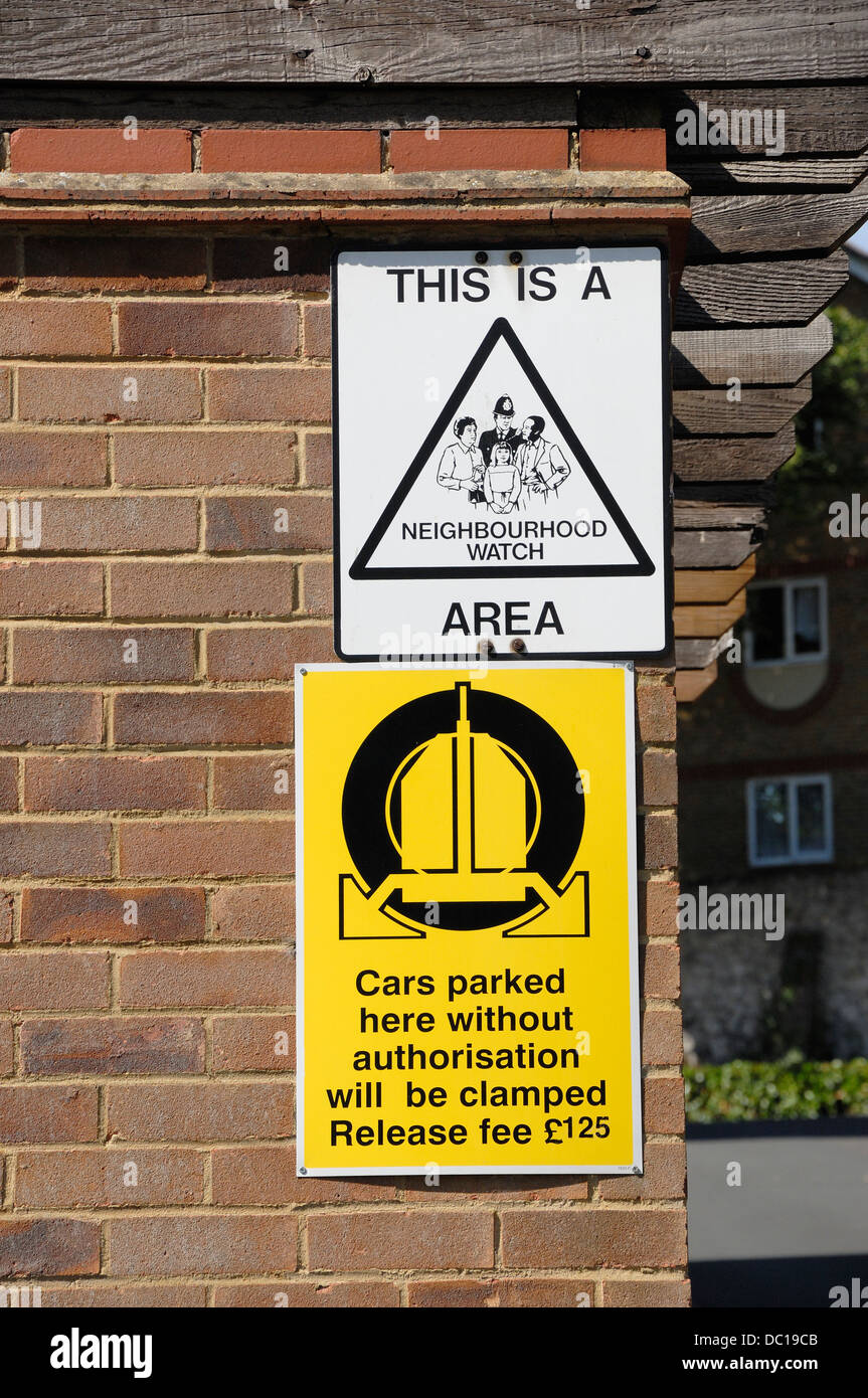 Maidstone, Kent, England, UK. Signs in residential area - Neighbourhood Watch and wheel clamping - Stock Image