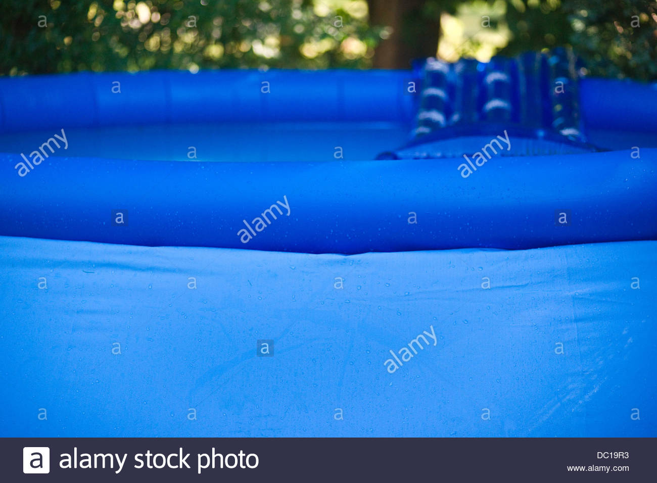blue plastic inflatable swimming pool - Stock Image