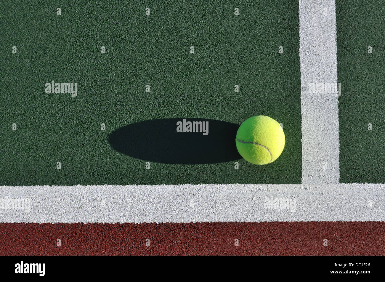 Tennis ball on a court - Stock Image