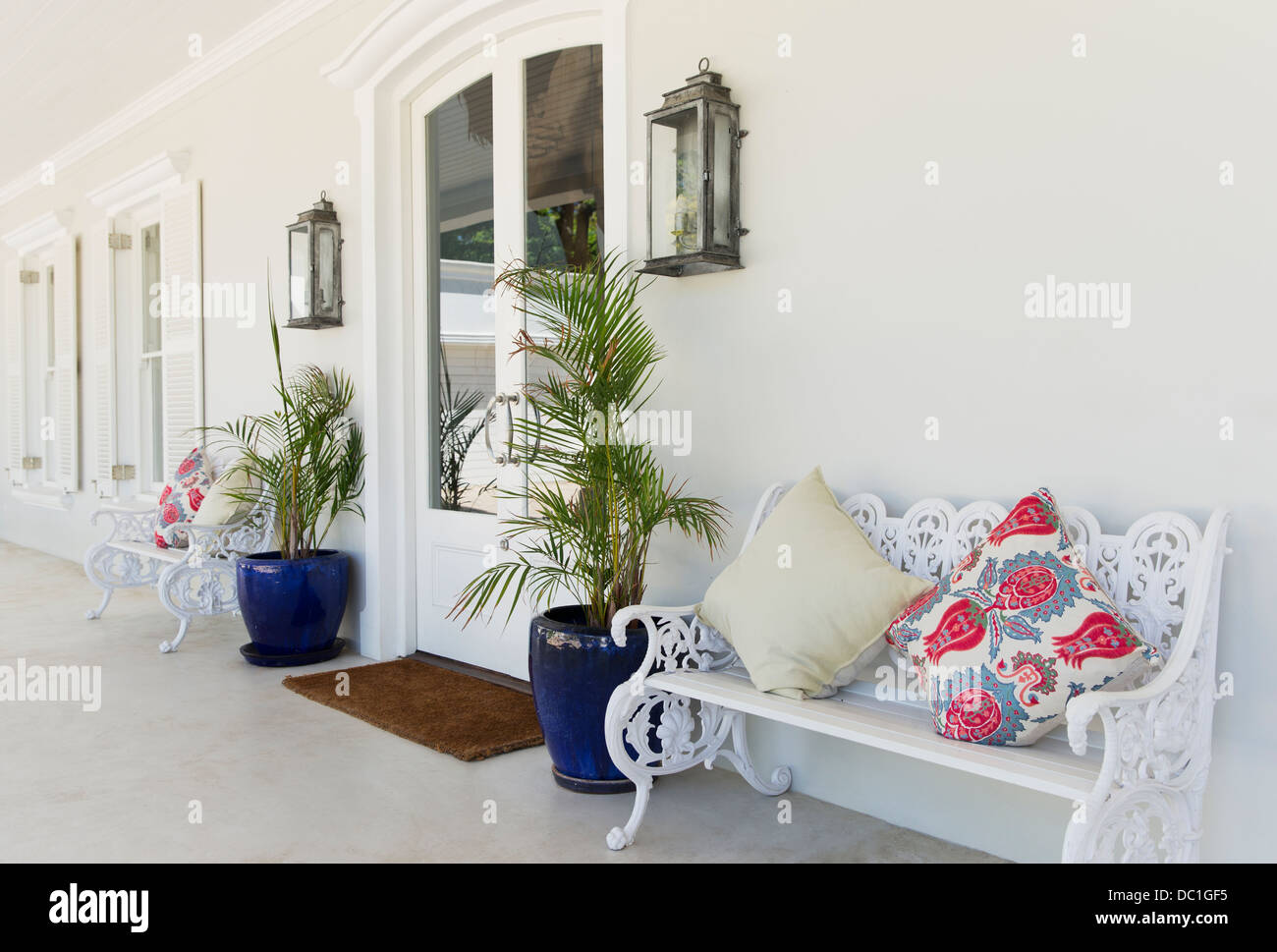 Bench with cushions on porch - Stock Image